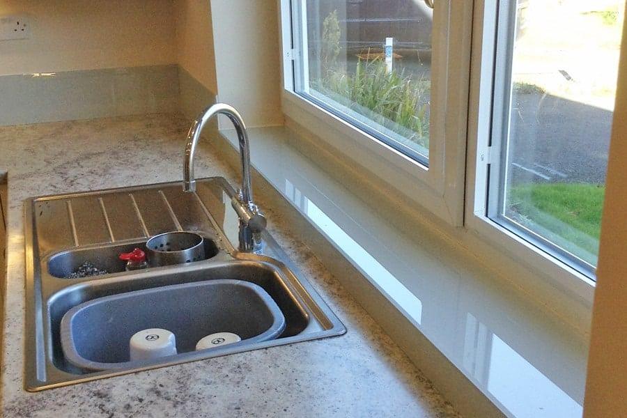 Light Apple Green Splashbacks, Grey Upstands & Window Sills Glass Splashbacks