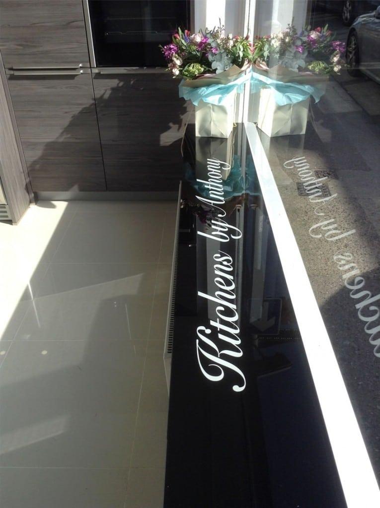 Jet Black Glass Window Sill With Added Company Logo Glass Splashbacks