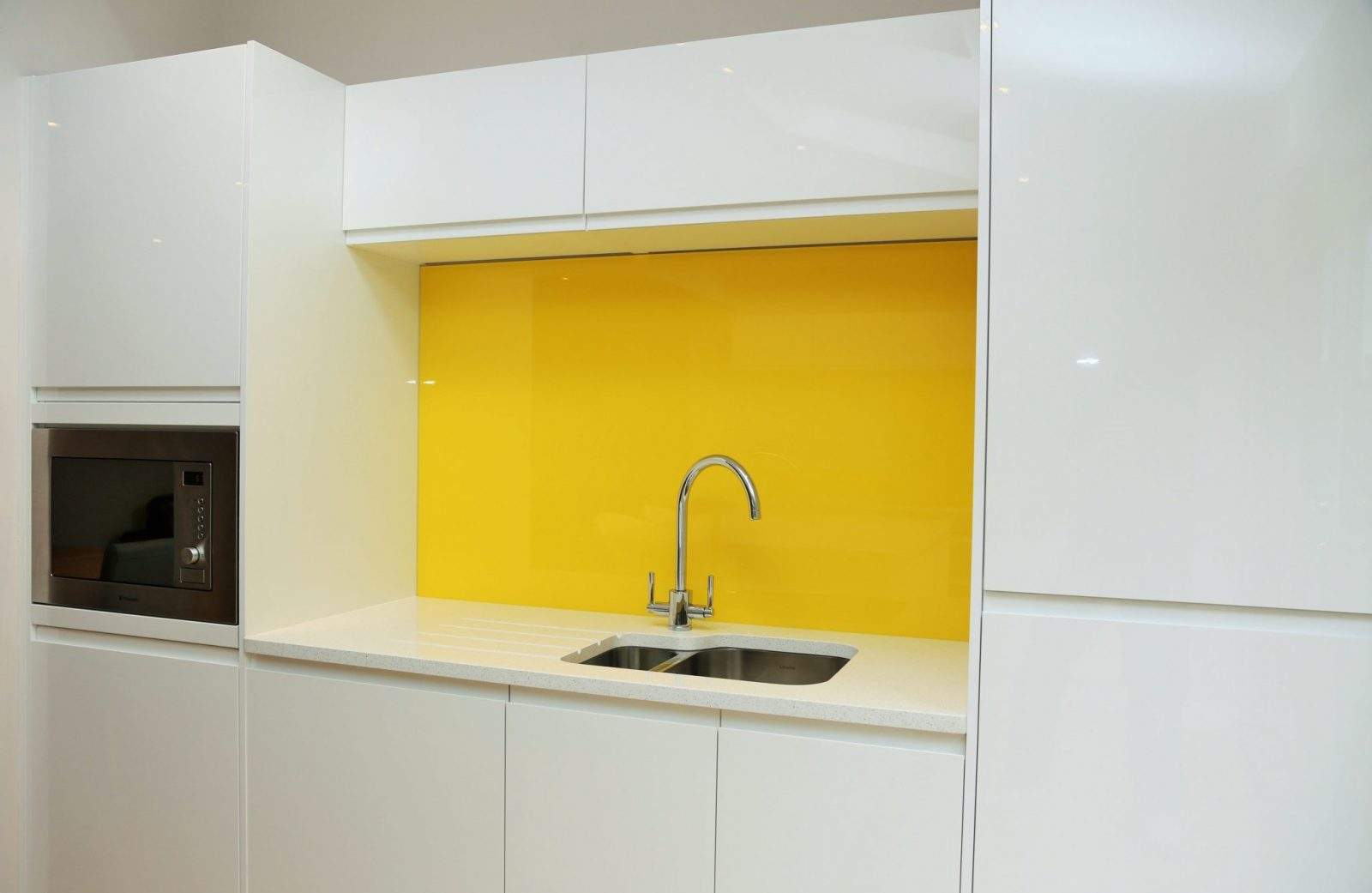 kitchen glass splashbacks upstands finished in sunflower yellow