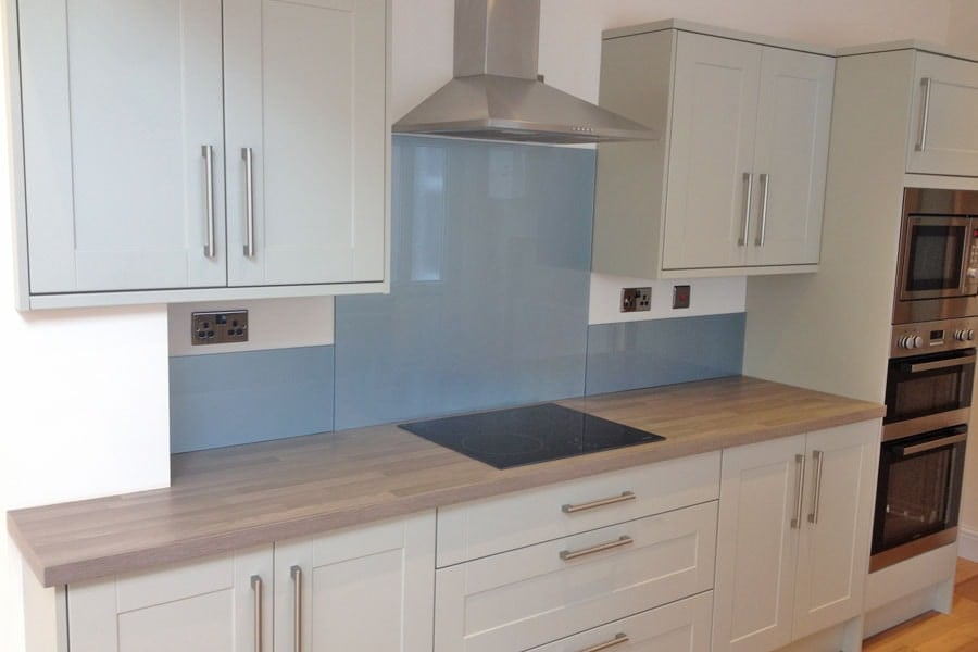 Glass Splashback For The Kitchen Painted In Steel Blue