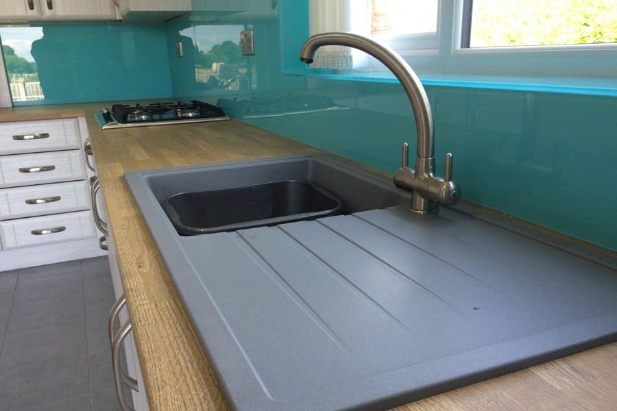 Aqua Blue Glass Upstand Behind Kitchen Sink