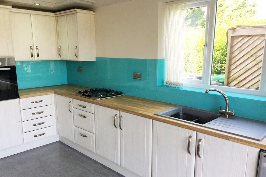 Aqua blue glass splashback amp window sill in cheshire
