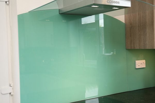 behind the hob glass splashback coloured in farrow ball arsnic