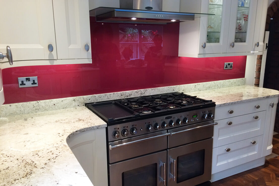 brand-new-kitchen-fitted-with-a-painted-glass-splashback-from-farrow-and-ball