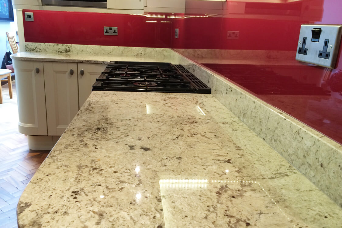 glass-splashback-fitted-on-a-marble-surface