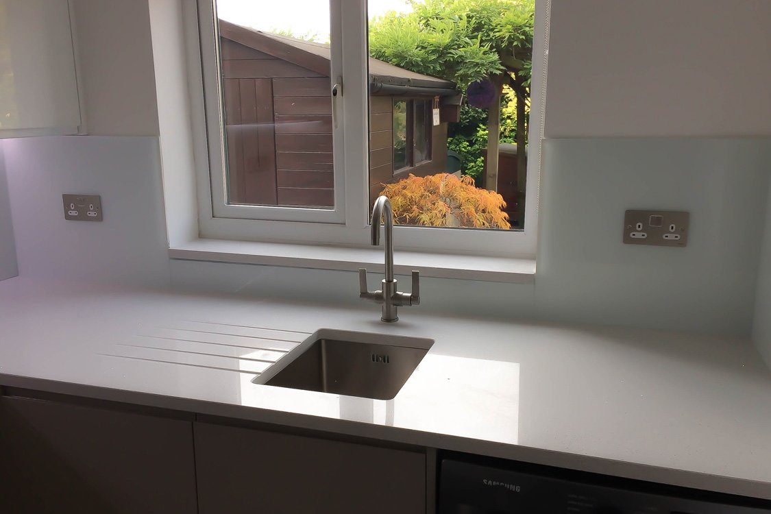Glass splashbacks for bathroom sinks - Glass Splashback Sat Behind Aluminium Tap And Sink