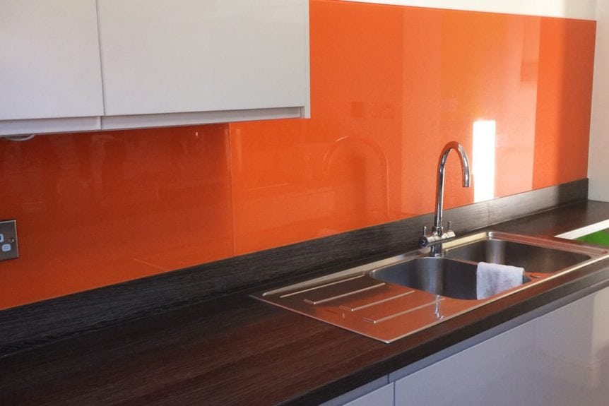 bright red orange glass splashback with sparkle