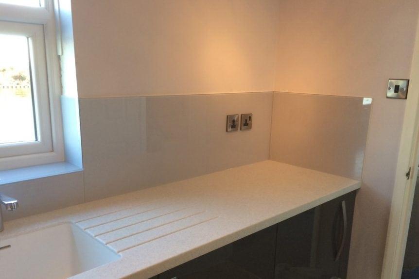 full glass splashback application in modern kitchen