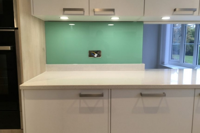 glass splashback behind marble countertop prestbury