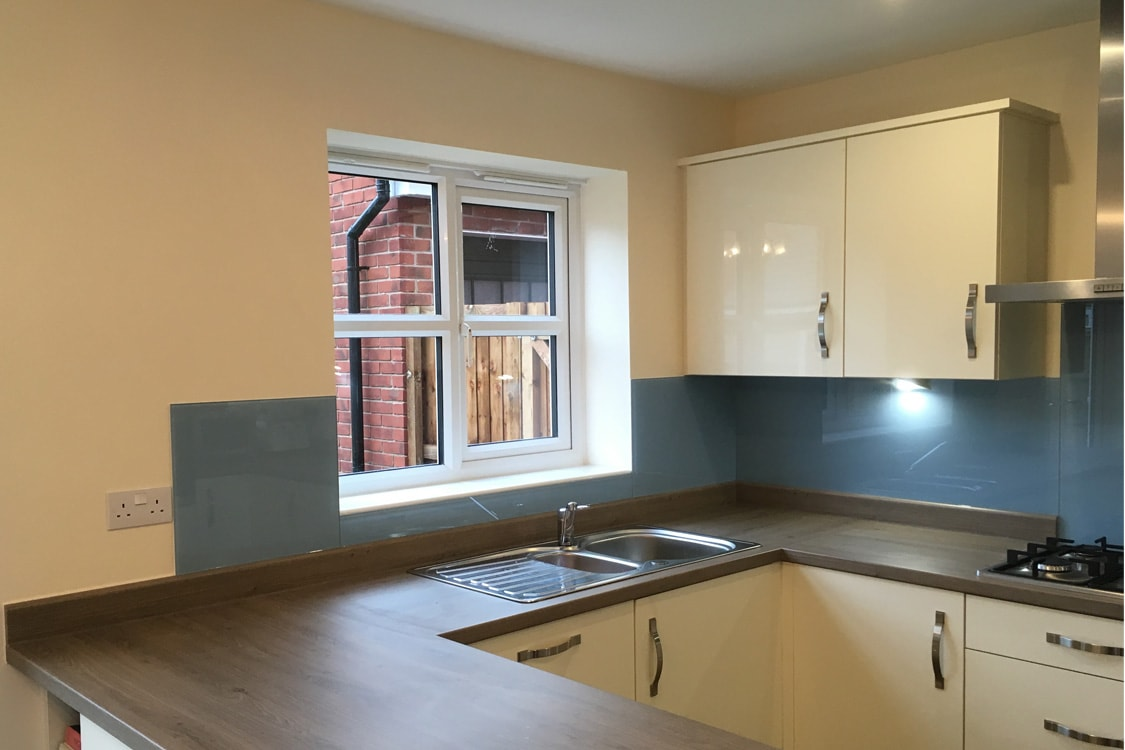 glass splashback coloured in lulworth blue from farrow and ball