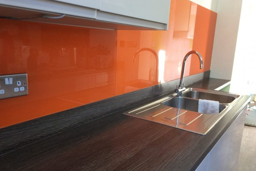 glass splashback fitted behind sink with sparkle