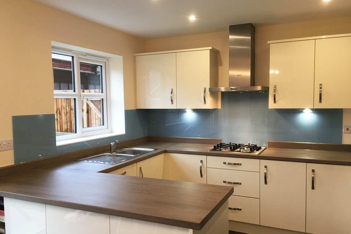 kitchen glass splashback coloured in farrow and ball lulworth blue