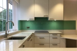 modern kitchen fitted with pure mint glass splashback