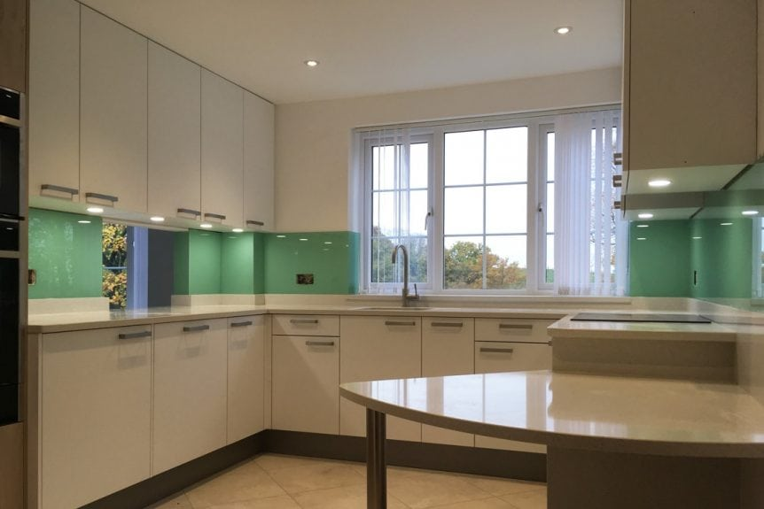 stunning glass splashback fitted in modern kitchen