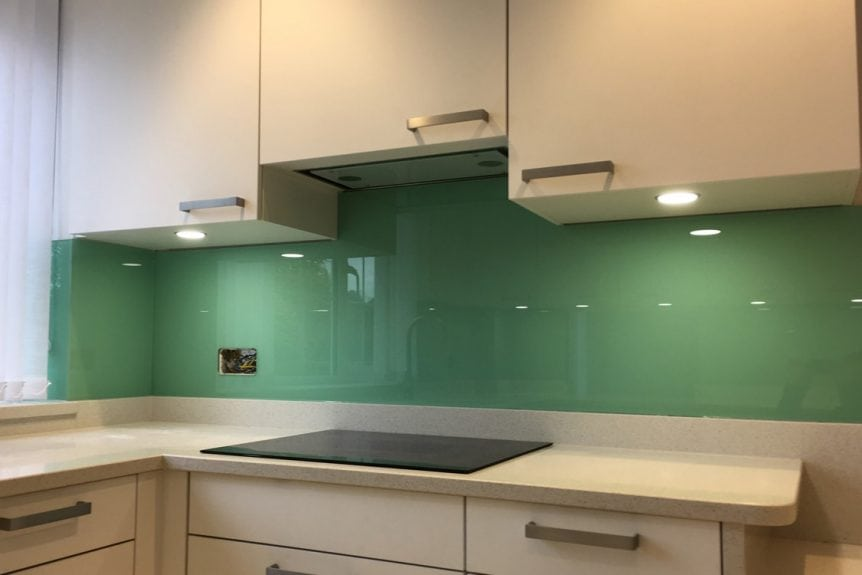 stunning kitchen glass splashback coloured in pure mint