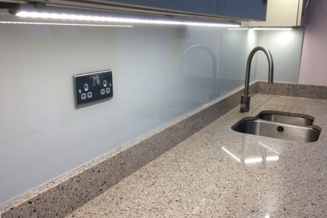 Glass Splashback with Socket Cutout Coloured in Farow and Ball Pavilion Grey