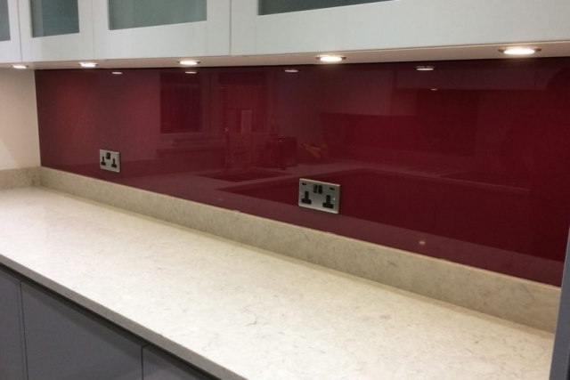 Glass splashback in one piece on top of granite worktop