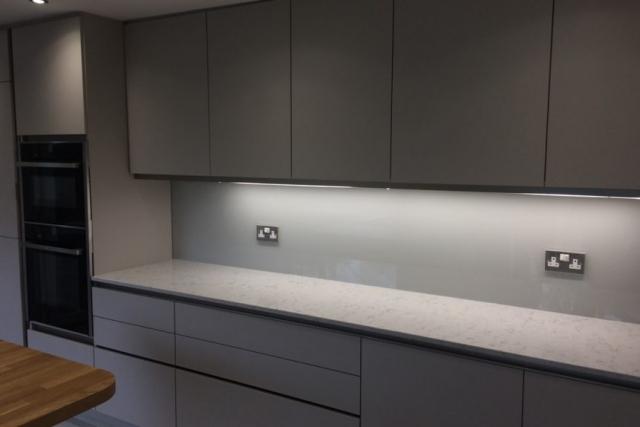 modern kitchen fitted with ammonite glass splashback