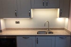 Pavilion Grey Glass Splashback Sat on Granite Upstand