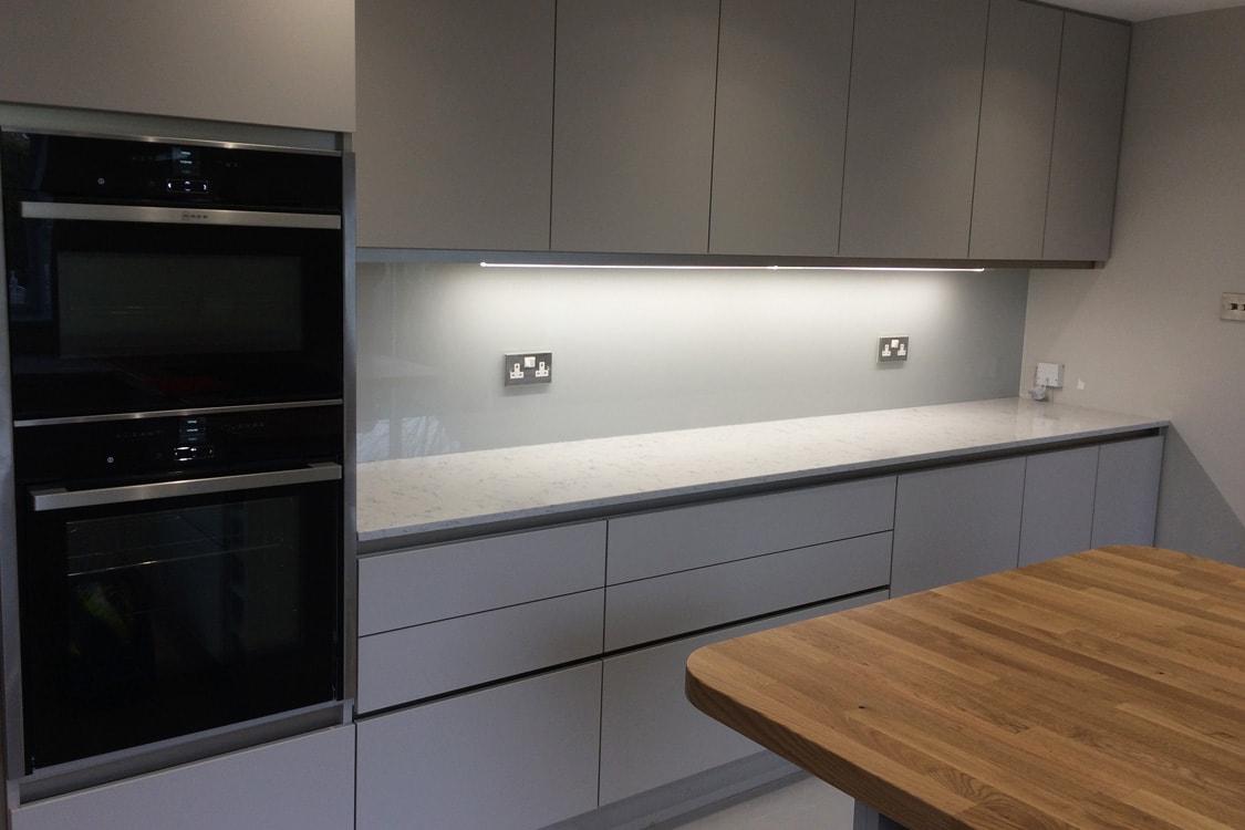 stunning glass splashback fitted in modern kitchen