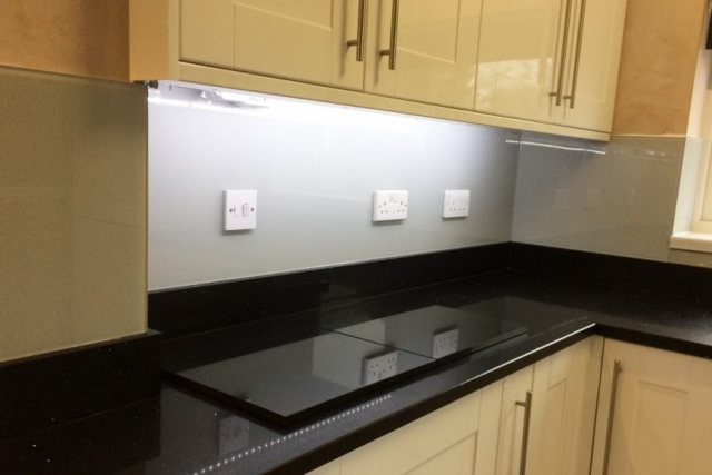 Glass Splashback Behind Cupboards Coloured in Pavilion Gray