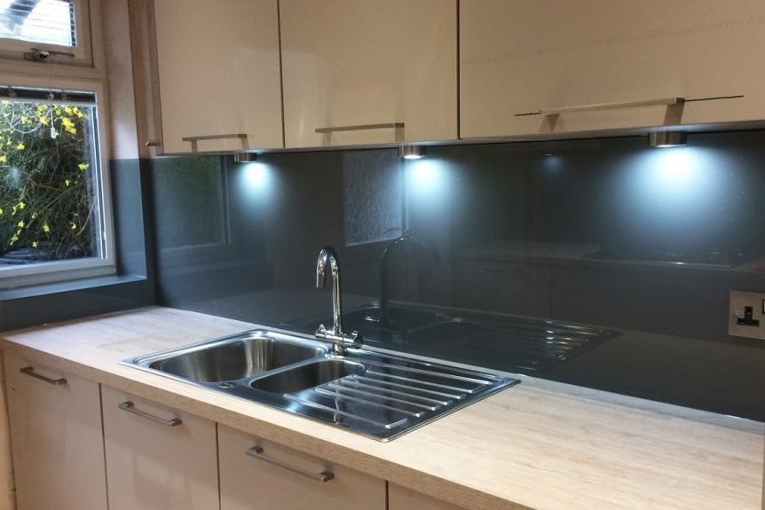 Glass Splashback Behind Kitchen Sink coloured in Farow and Ball Plummet
