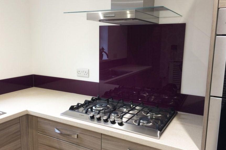 Glass Splashback Behind the Kitchen Hob Coloured in Aubergine