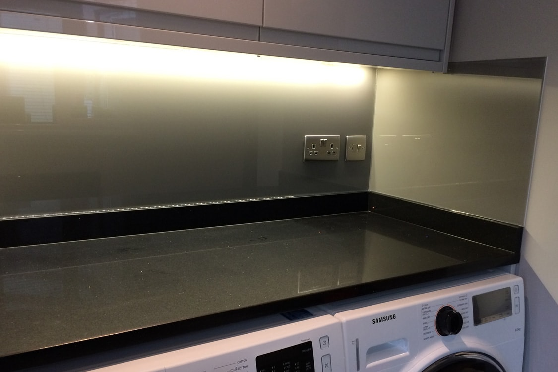 Glass Splashback Coloured in Moles Breath with Socket Cutout