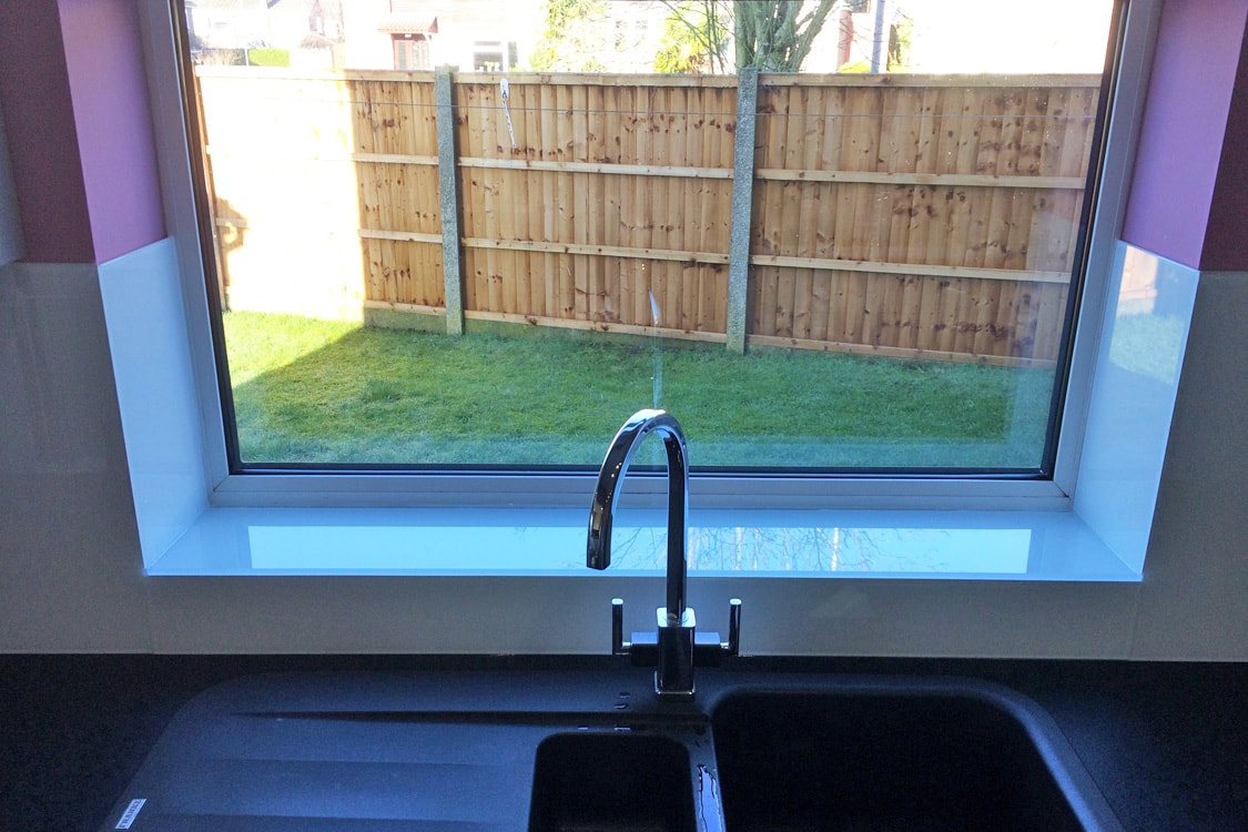 Glass Upstand With Window Sill Coloured in Arctic White