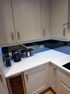 Grey Mirrored Glass Splashback With Socket Cutouts