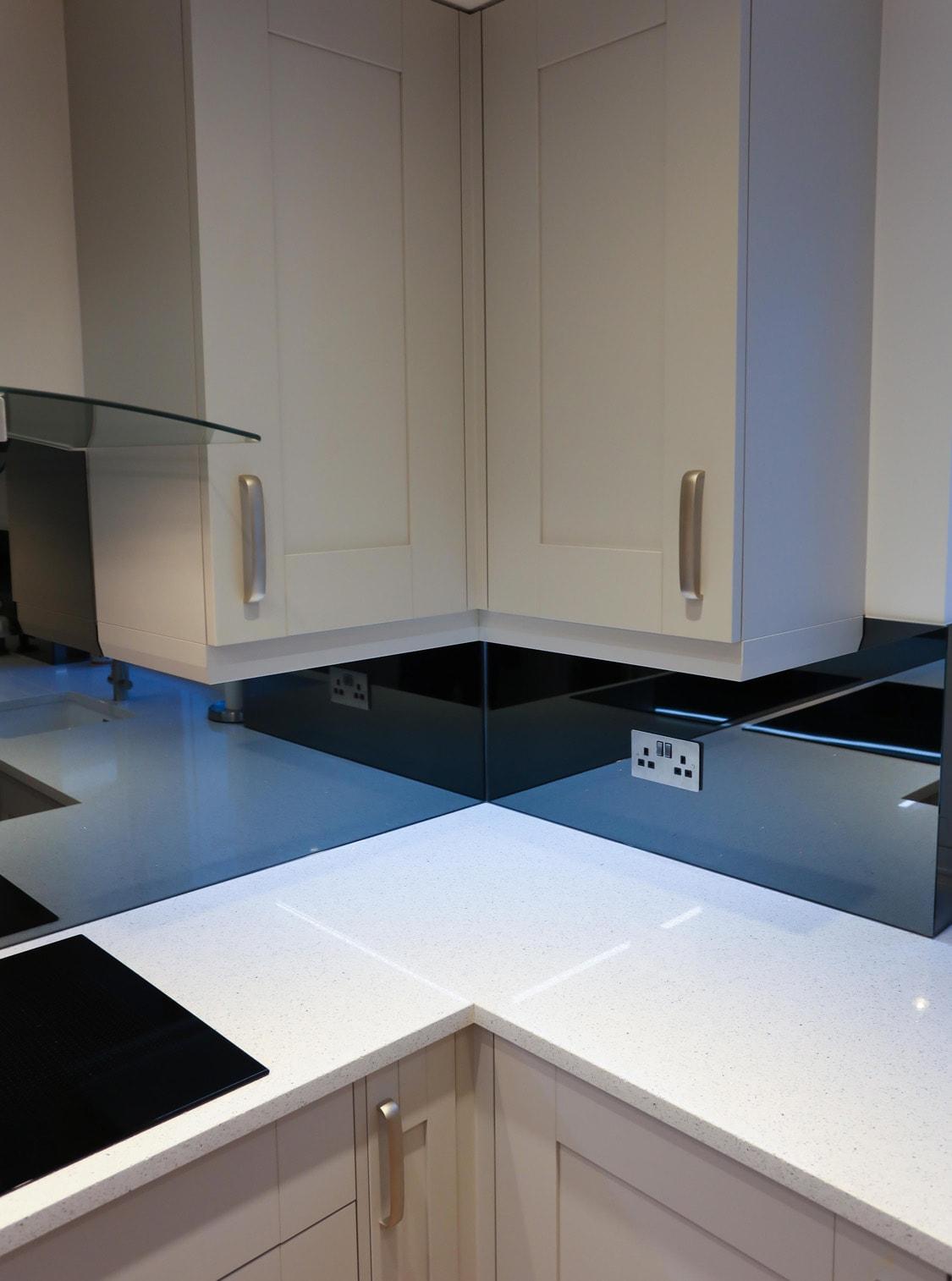 Mirrored Glass Splashback Under Cupboards