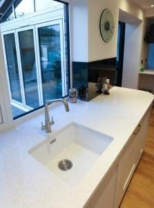 Mirrored Grey Glass Side Returns Behind Kitchen Sink