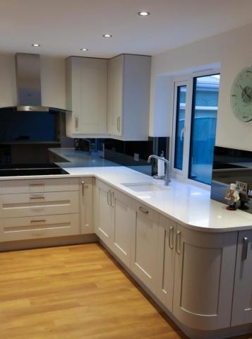 Mirrored Grey Glass Splashback Behind Sink