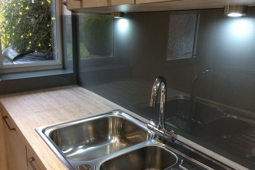 Modern Kitchen fitted with a Glass Splashback