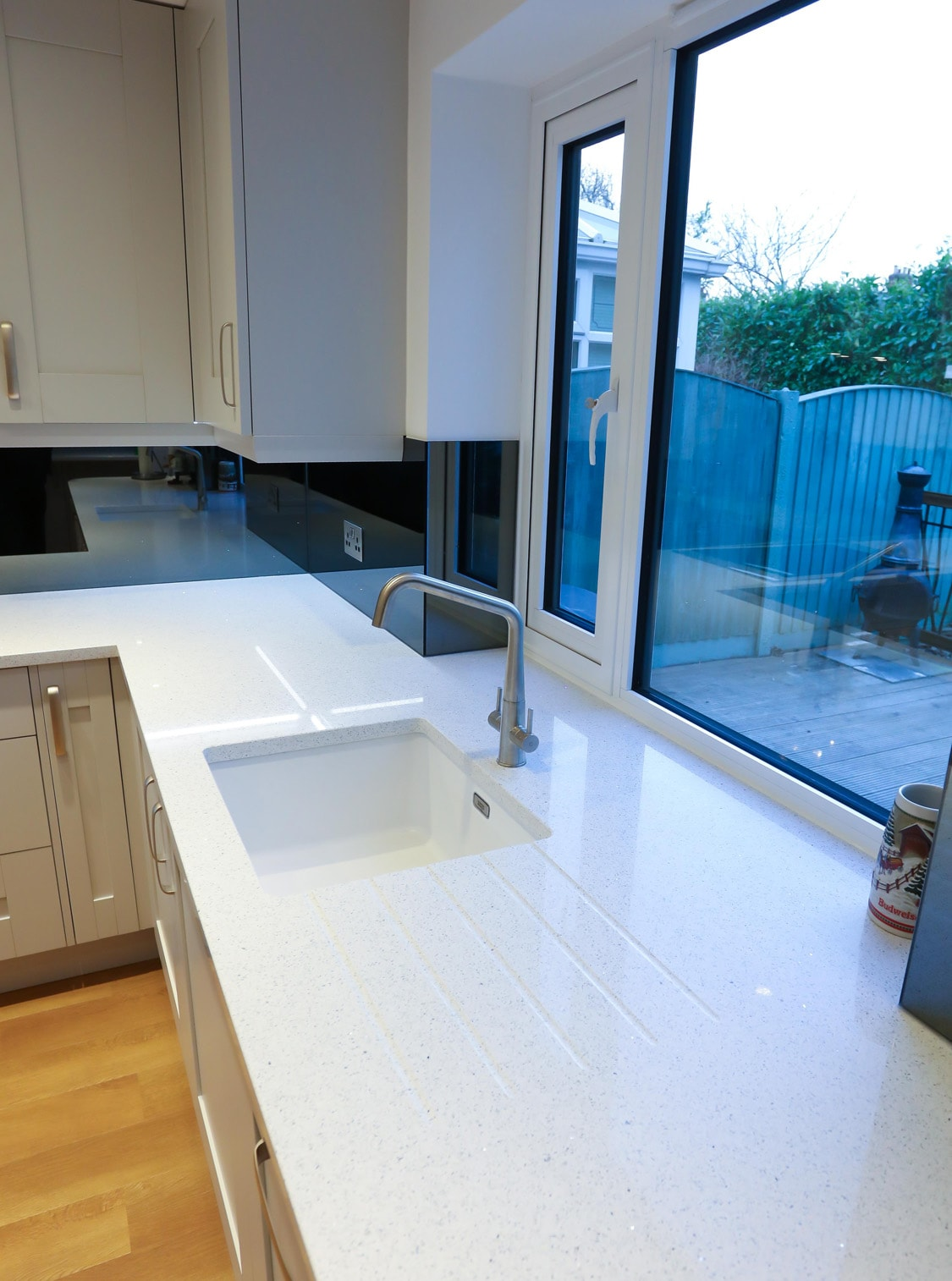 Stunning Mirrored Glass Finishing Touch to this Kitchen