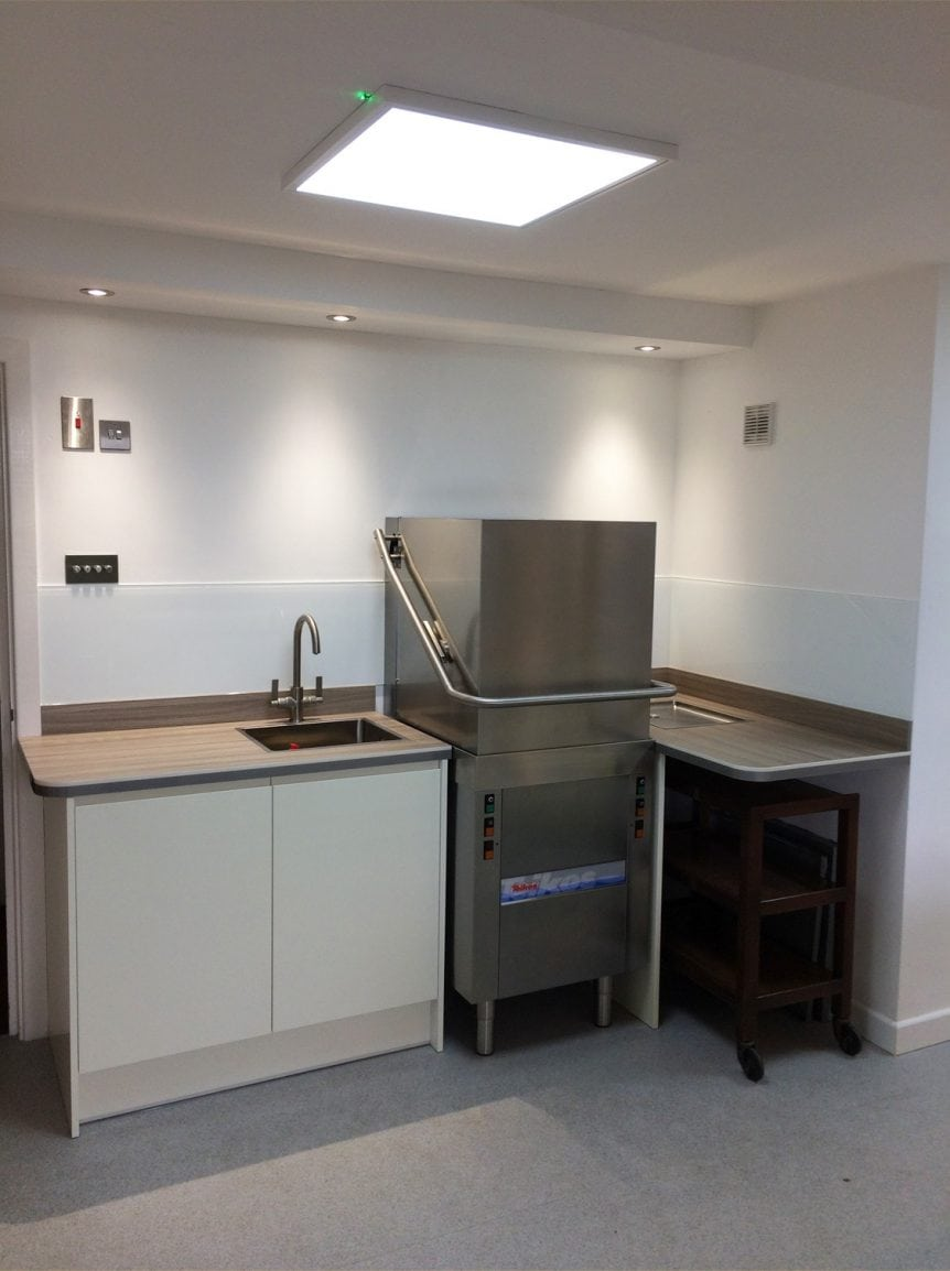 Commercial Kitchen Fitted with Glass Splashback COloured in Dulux Flat White