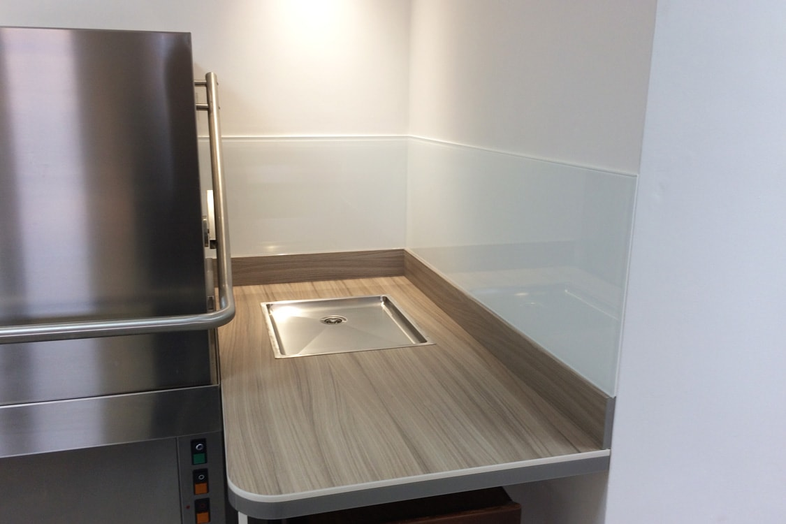 Glass Splashback Coloured in Dulux Flat White Behind Commercial Kitchen Dishwasher
