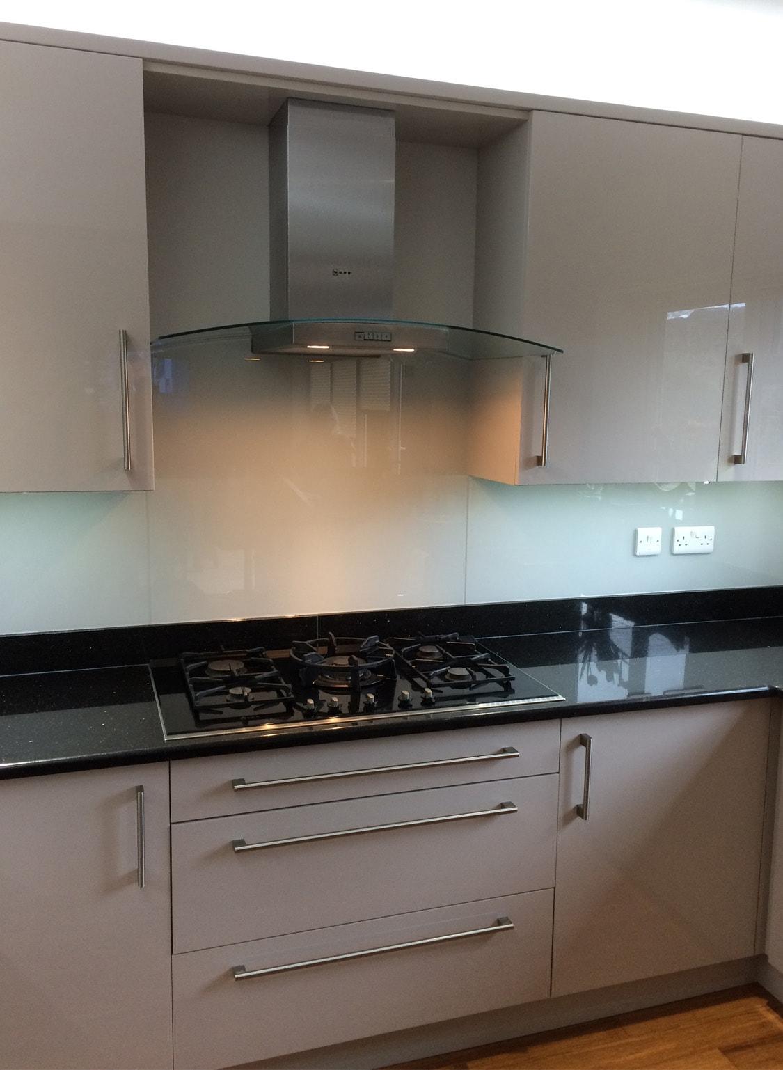 Kitchen Glass Splashback Ontop of Black Granite Worktop