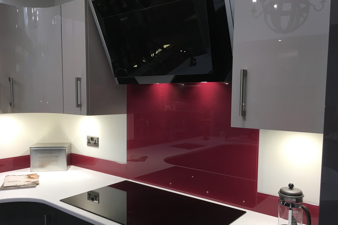 Close Up Of Glass Splashback Fitted Behind Neff Hob