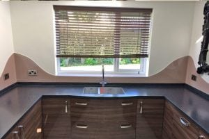 Curved Kitchen Glass Splashback Fitted in Cheshire and Coloured in Dulux Muddy Puddle