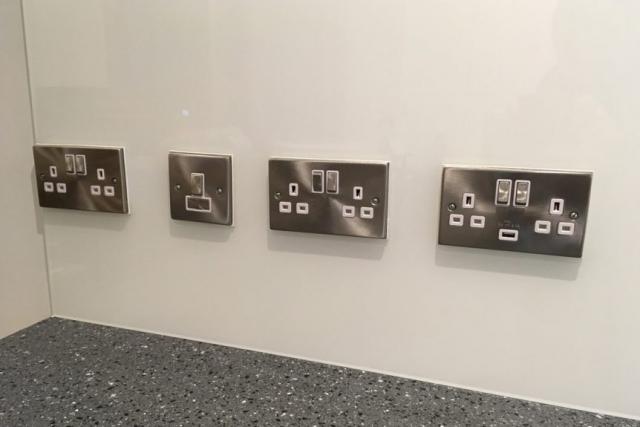 Four Plug Socket Cutouts in Kitchen Glass Splashback