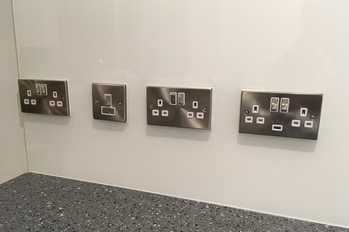 Four Plug Socket Cutouts in Kitchen Glass Splashback