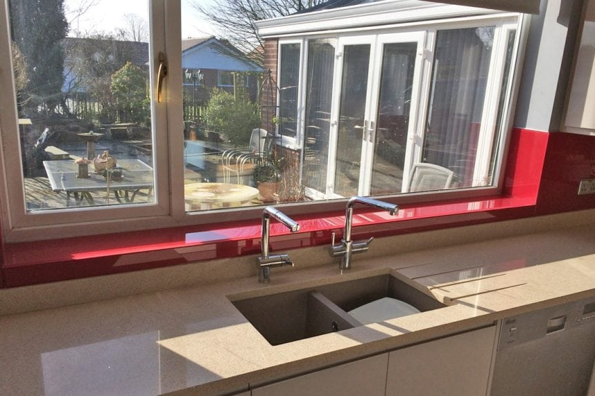 Glass Kitchen Window Sill Colored in Red