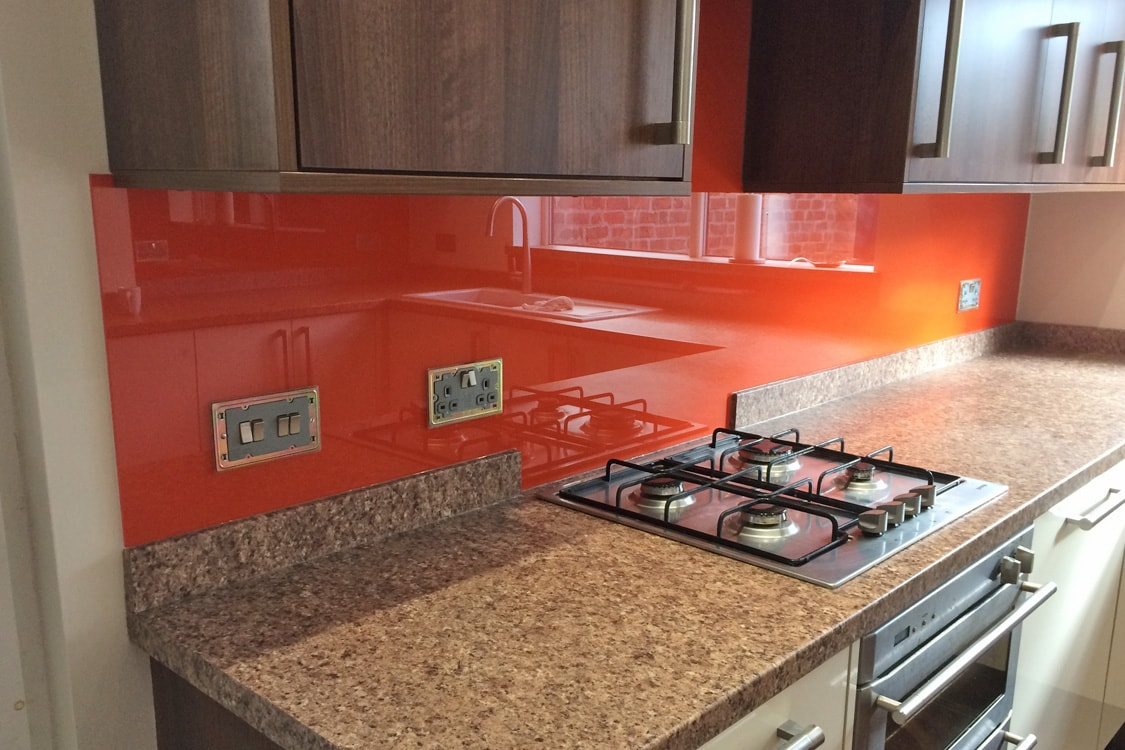 Glass Splashback Cut into a Cross Behind Kitchen Hob
