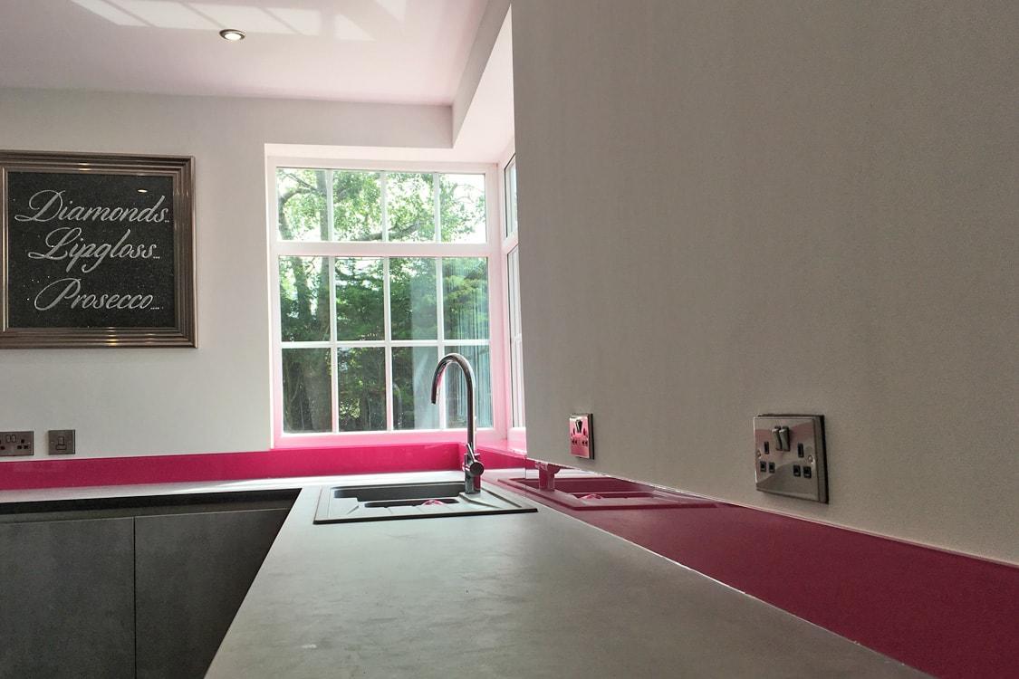 Hot Pink Glass Splashback Behind Sink