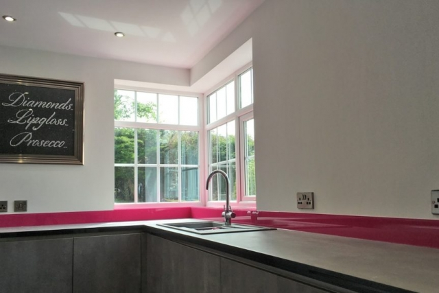 Hot Pink Glass Window Sill in Kitchen