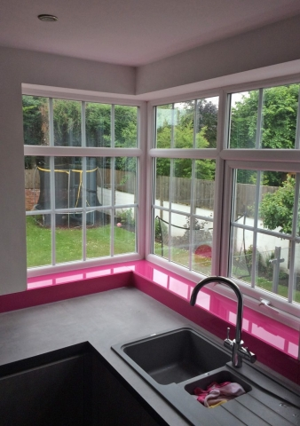Kitchen Glass Window Sill and Upstands Coloured in Hot Pink