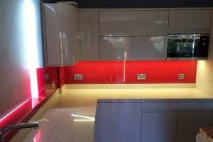 Red Glass Splashback with LED Lights under Cupboards
