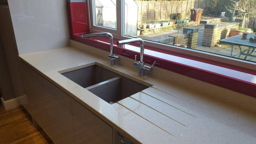 Luxury Red Glass Window Sill Behind Chrome Sink Taps