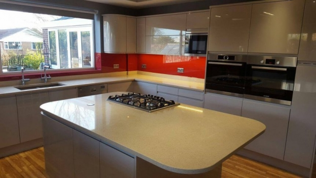 Red Kitchen Glass Splashback Fitted by Vale Royal Kitchens Winsford